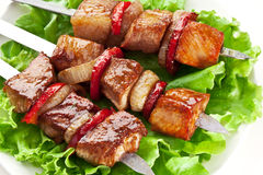 Grilled kebab (shashlik) on spits. Royalty Free Stock Photography