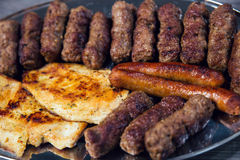 Grilled kebab, turkish style barbecued meat. On wooden table Royalty Free Stock Images