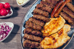 Grilled kebab, turkish style barbecued meat. On wooden table Royalty Free Stock Photos