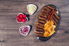 Grilled kebab, turkish style barbecued meat. On wooden table Stock Photos