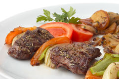 Grilled kebab with vegetables Stock Image