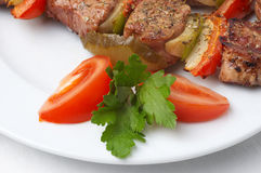 Grilled kebab with vegetables Stock Images