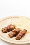Grilled kebabs in bacon with mashed potatoes Royalty Free Stock Photography