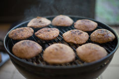 Grilled Kibbeh (Kebbeh) on the grill. BBQ (Barbecue) Stock Photography