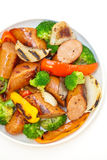 Grilled kielbasa and vegetables Stock Photo