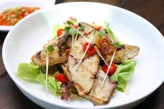 Grilled King Oyster Mushroom , Eryngii slices with sunflower spr. Out and green oak lettuce on white plate Stock Photo