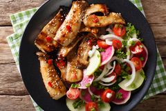 Grilled king oyster mushrooms and salad of radishes and tomatoes Royalty Free Stock Photography