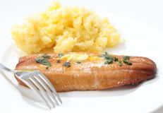 Grilled kipper and mashed potato and fork Royalty Free Stock Photography