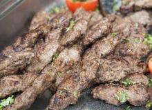 Grilled kofta meat at an oriental restaurant buffet Royalty Free Stock Photos