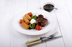 Grilled lamb chop with green asparagus and croquettes Stock Photos
