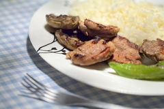 Grilled lamb chop and mushroom with rice. Close-up photograph of grilled lamb chop with rice at dish on table Royalty Free Stock Photo