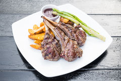 Grilled lamb chop steak. With french fries in white plate Royalty Free Stock Images