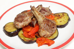 Grilled lamb chops on salsa Stock Photo