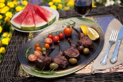 Grilled Lamb Chops In Garden Stock Image