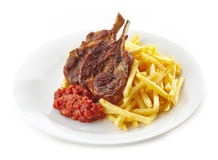 Grilled lamb meat and french fries Stock Photos
