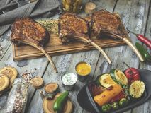 Grilled lamb,mutton meat chops with vegetables on a serving board. Rustic food concept.  stock images