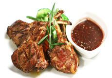 Grilled Lamb Rib. Served with spicy sauce Royalty Free Stock Images