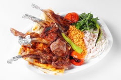 Grilled Lamb Ribs with Herbs and Pide Served Over White Plate Stock Photos