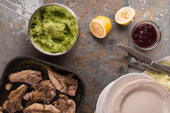 Grilled lamb ribs, mashed potatoes, beetroot sauce, plates, forks on the table Royalty Free Stock Photo