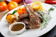Grilled Lamb. With rosemary and assorted vegetables stock images