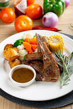 Grilled Lamb. With rosemary and assorted vegetables stock photos