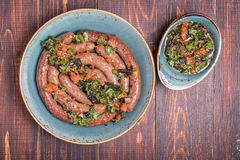 Grilled lamb sausage served with salsa Royalty Free Stock Photos
