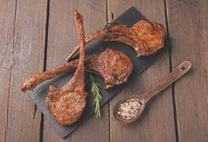Grilled lamb veal ribs loin on a stone surface Royalty Free Stock Photography