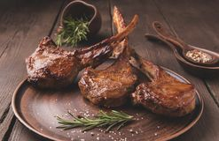Grilled lamb veal ribs loin on a stone surface Royalty Free Stock Photo