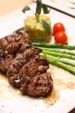 Grilled lamb on white plate Royalty Free Stock Images
