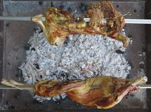 Grilled lambs. Appetizing lambs cooked on a spit Royalty Free Stock Photos