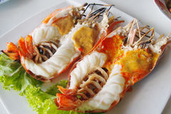Grilled large river prawns. On white plates Stock Image