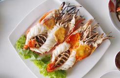 Grilled large river prawns. On white plates Royalty Free Stock Images