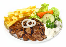 Grilled lean beef nuggets, called Dönerteller or Doner Royalty Free Stock Images