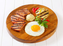 Grilled Leberkase with fried egg and mustard Royalty Free Stock Photos