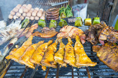 Grilled leg pork on the charcoal stove at the market Royalty Free Stock Photo