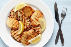 Grilled lemon chicken with garlic bread Stock Image