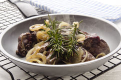 Grilled liver with onion and rosemary Royalty Free Stock Images