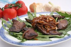 Grilled liver. Some fresh grilled liver with onions Royalty Free Stock Images