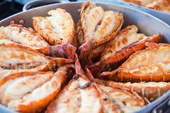 Grilled lobster. Pieces of fresh lobster being grilled Royalty Free Stock Photos