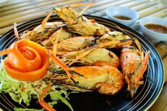 Grilled lobster in fire eat for side dish Stock Images