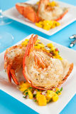 Grilled lobster tails. With mango salsa royalty free stock photography
