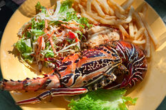 Grilled lobster on yellow plate Stock Photography