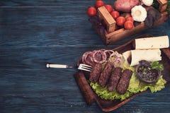 Grilled lula kebab Stock Images