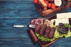 Grilled lula kebab Stock Photos