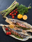 Grilled mackerel with asparagus Stock Photos