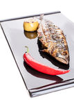 Grilled mackerel on a black plate Stock Photography