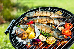 Grilled mackerel fish with baked potatoes stock images
