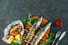 Grilled mackerel fish with baked potatoes Royalty Free Stock Photo