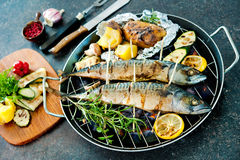 Grilled mackerel fish with baked potatoes Royalty Free Stock Photography