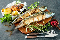 Grilled mackerel fish with baked potatoes Stock Photography